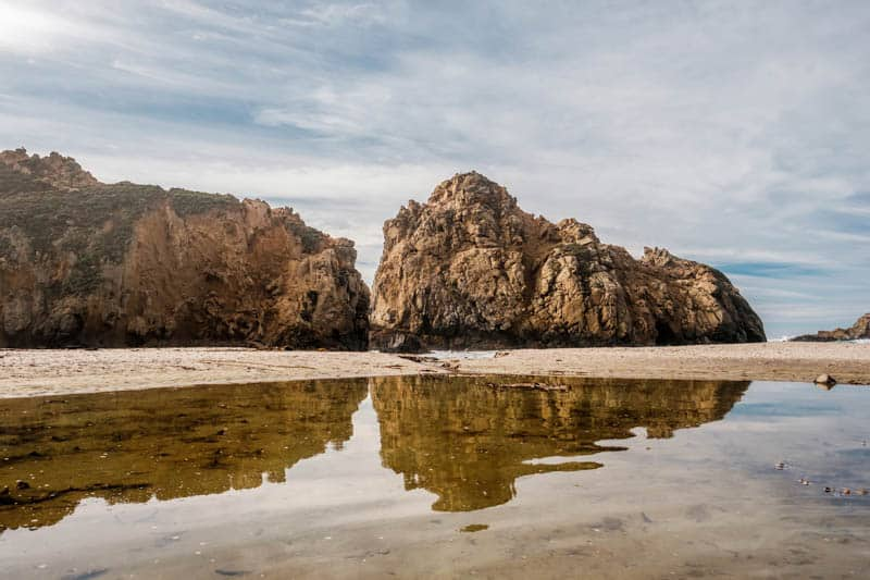 Sea stack reflections at Pfeiffer Beach in Big Sur California