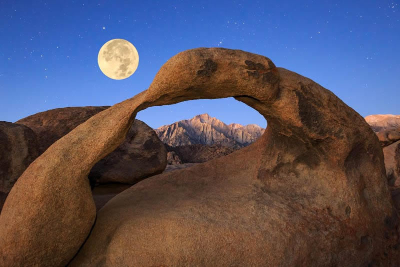 Full moon behind Mobius Arch in the Alabama Hills