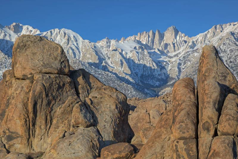 The rounded shapes of the Alabama Hills against the jagged Sierra Nevada in California.