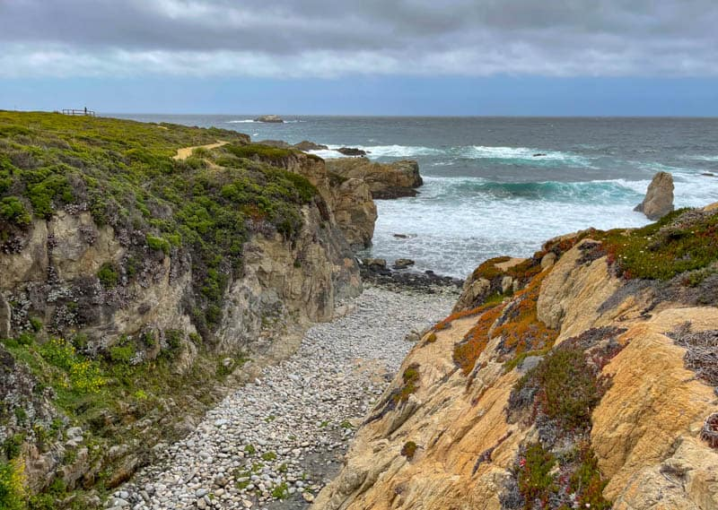 Soberanes  Creek flows into the Pacific Ocean at this pebbly cove in Garrapata State Park in California