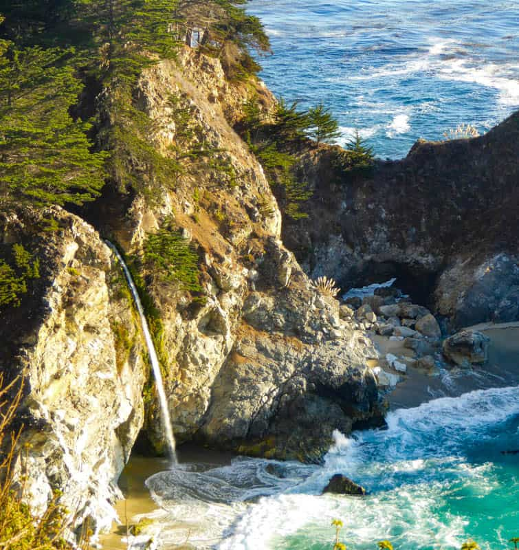 A close up view of McWay Falls from the side of California Highway 1