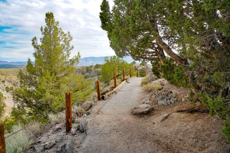 Steep asphalt trail at Hot Creek Geological Site in Mammoth Lakes
